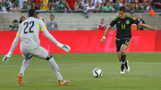 Mexico's Javier Hernandez shoots the ball against Ecuador goalkeepper Alexander Dominguez during the first half of Saturday's game at the Los Angeles Memorial Coliseum.
